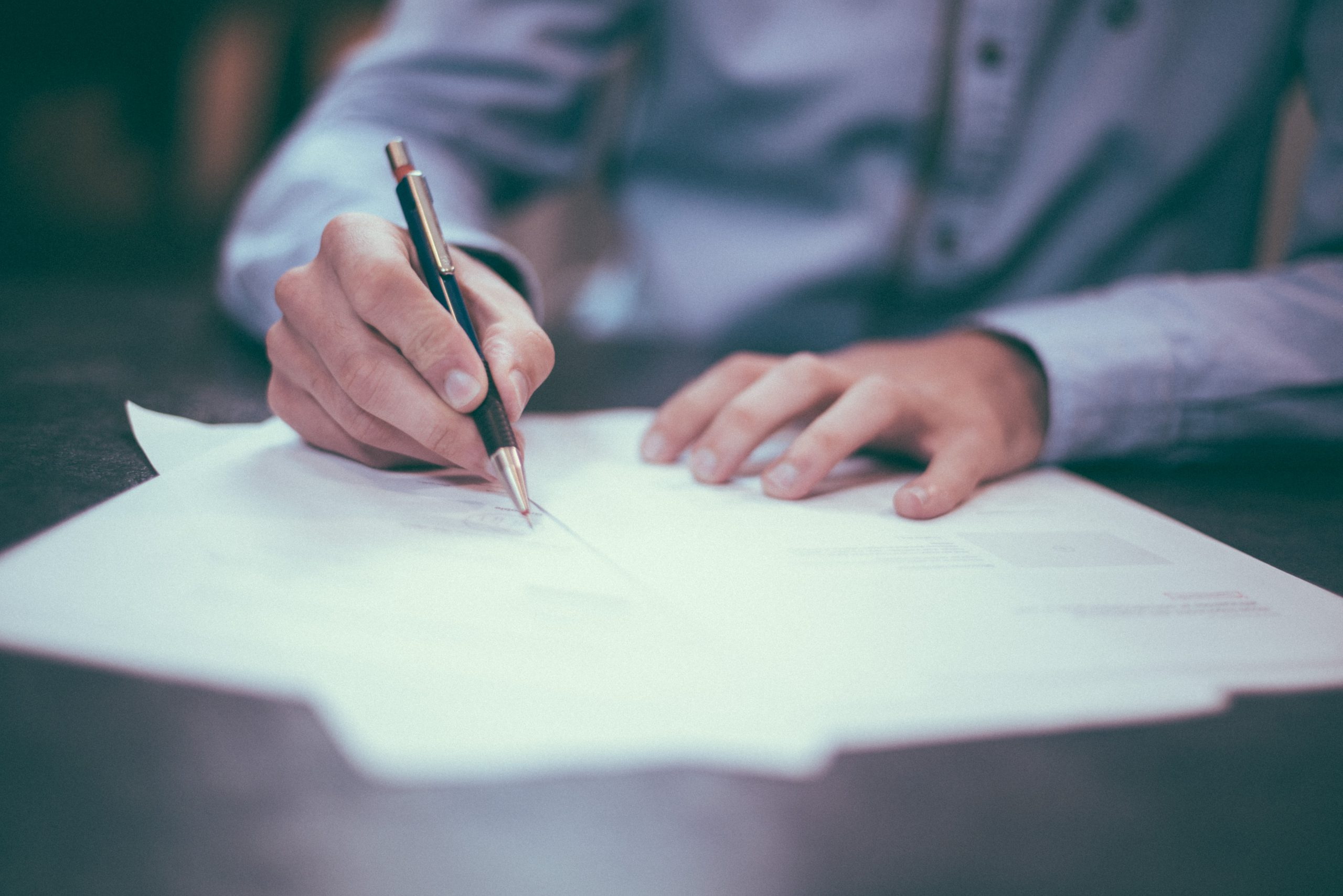 male hand signing permit papers